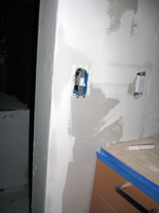 both sides of wall had to be patched from where we tore down the old cabinet wall